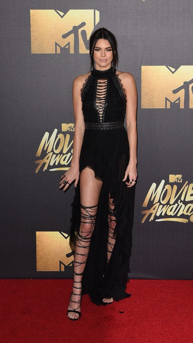 On Jenner: Kristian Aadnevik gown with lace-up details; DSquared2 thigh-high lace-up sandals; Lorraine Schwartz jewelry.