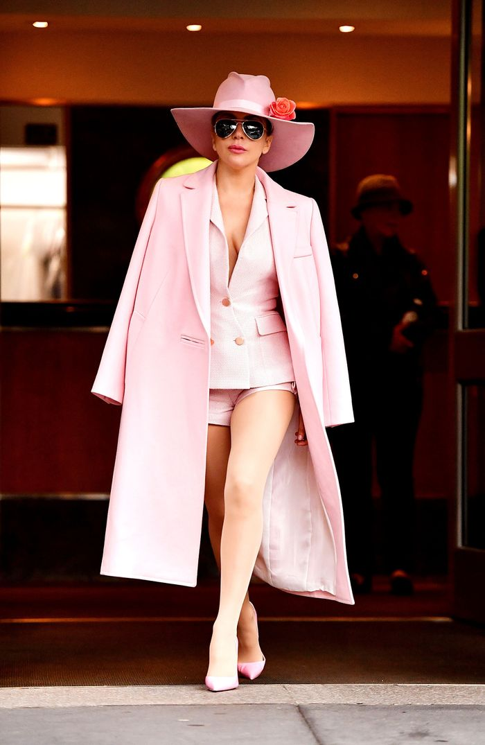Lady Gaga in a pink coat, jacket, shorts and shoes.