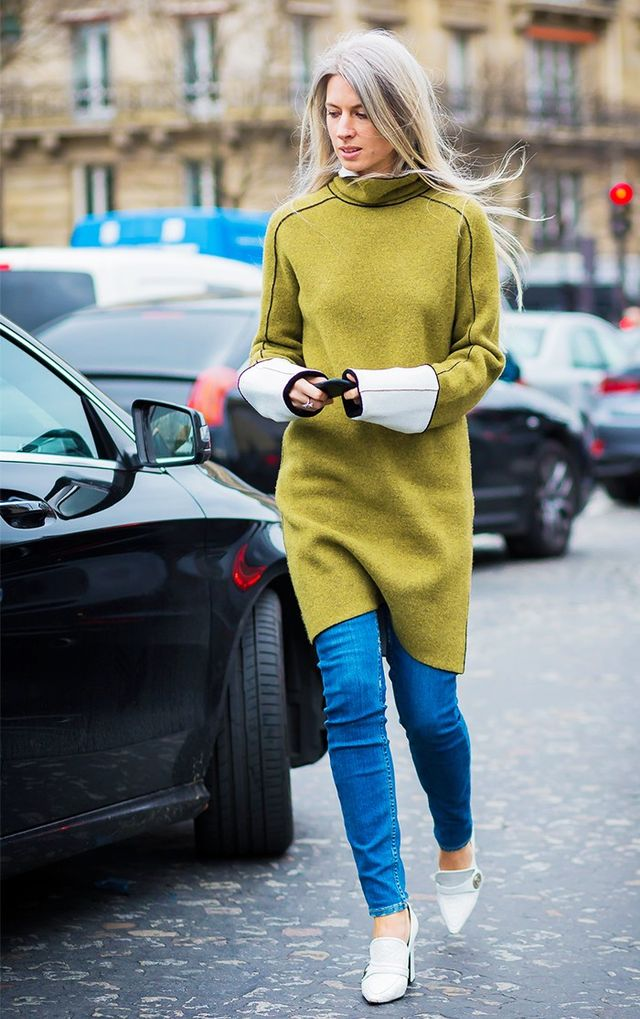 Try styling your jeans with a dress like this: