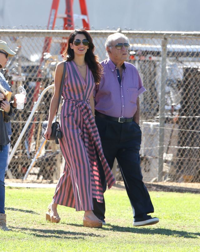 Amal Clooney wearing platforms and a striped tome dress