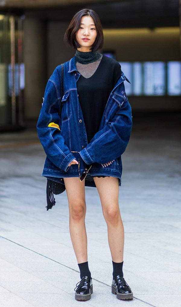 A Korean model wearing an oversized denim jacket at HERA Seoul Fashion Week
