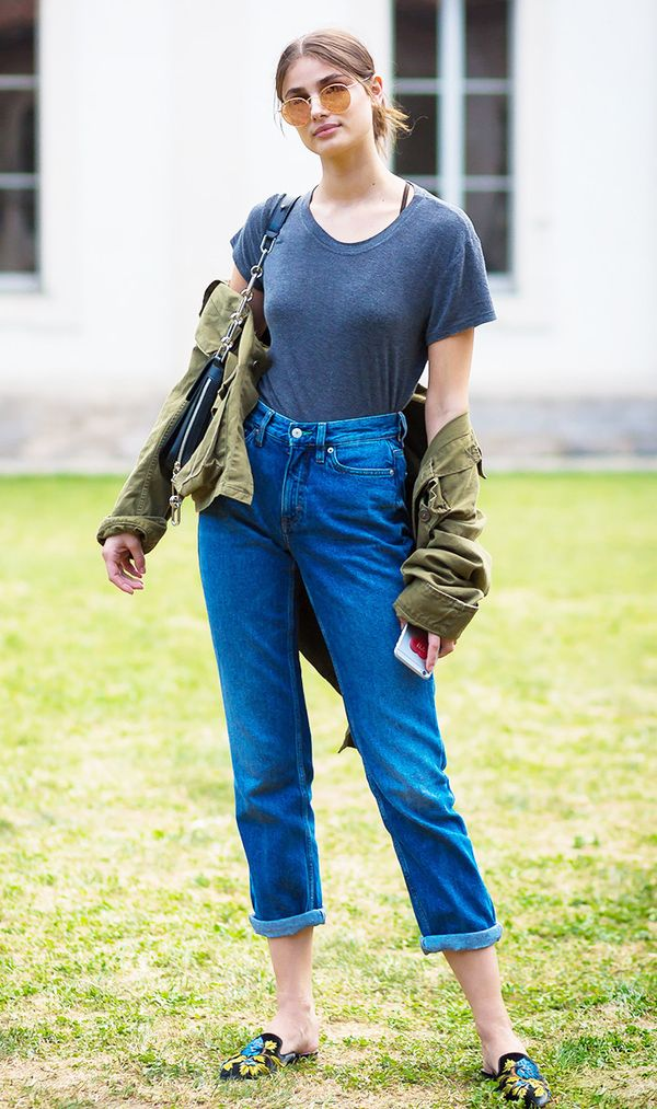 Taylor Hill embroidered slip-on slippers, cuffed jeans, t-shirt, and military jacket