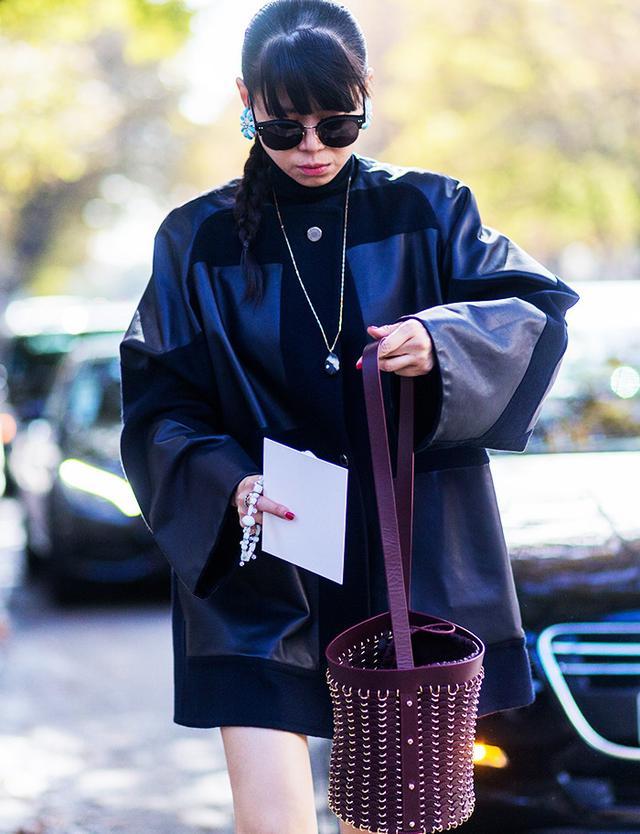 Leaf Greener wearing a bucket bag outside Giambattista Valli at Paris Fashion Week