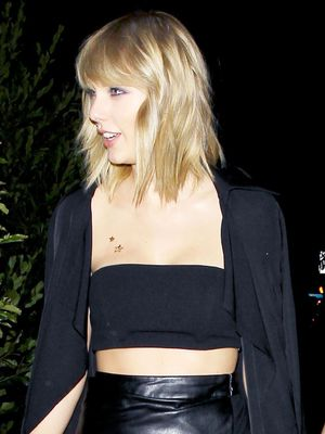 Taylor Swift Wore a $68 Trench Coat to Drake's Birthday Party—Shop It Here
