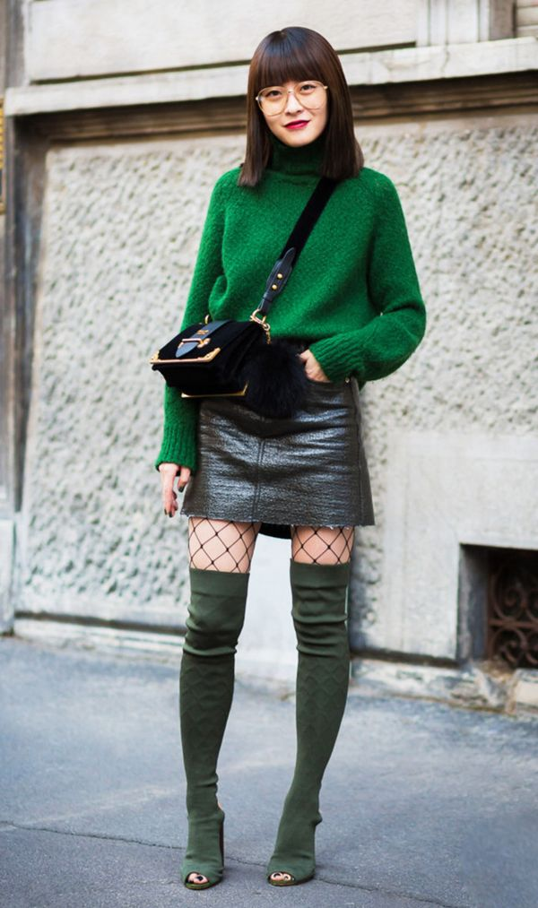 Street style green sweater, green thigh boots, leather skirt and crossbody bag