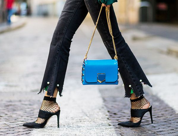 Fashion blogger Lisa Hahnbueck in dark black flare jeans, Ueterque shoes, Jimmy Choo bag, and ASOS tights