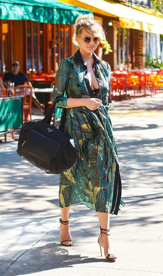 Chrissy Teigen wearing a camo dress.