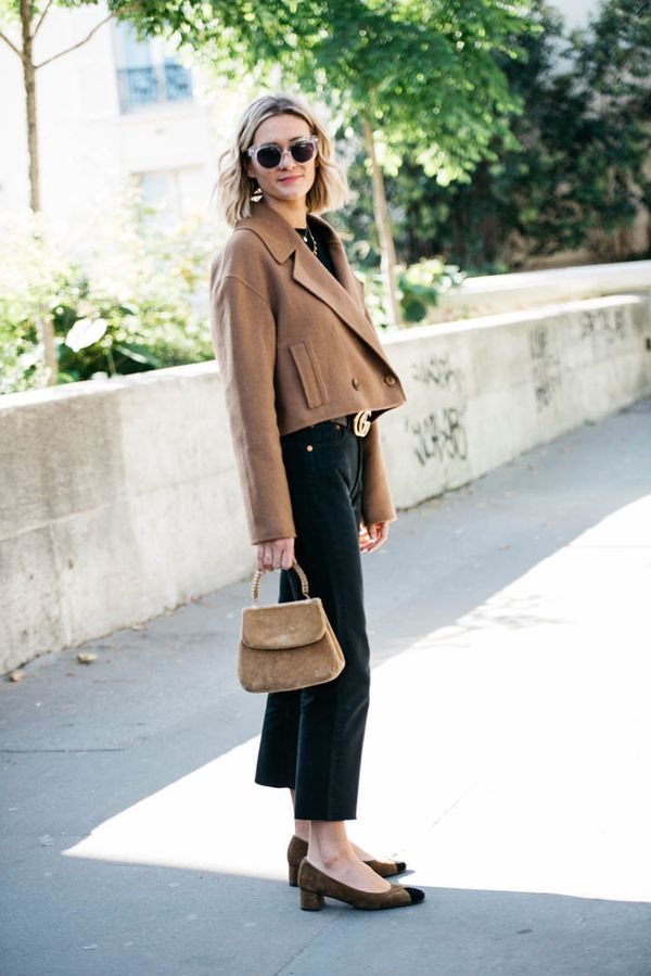 Adenorah in a camel coat and black vintage Levi's jeans