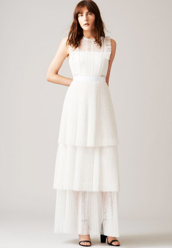 A more classic wedding look, this outfit stays contemporary with the tiered pleats.