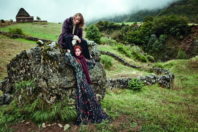 On Edie Campbell: Mango Knitted Braided Sweater ($80). On Natalie Westling: Mango Flowy Long Dress ($150) and Striped Textured Scarf ($30).