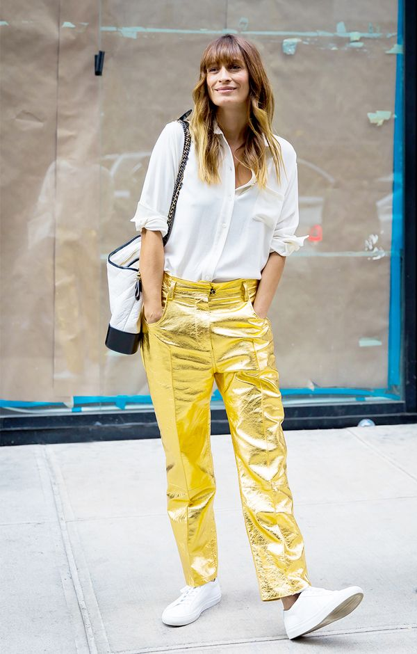 2. Tone a pair of party pants down with sneakers.