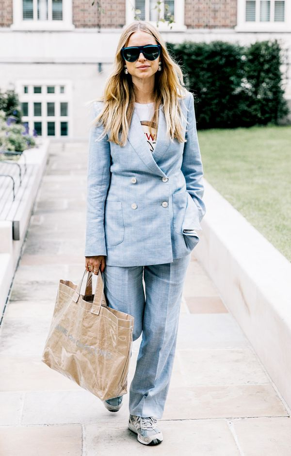 3. Transform a suit from business to casual with a graphic tee and sneaks.