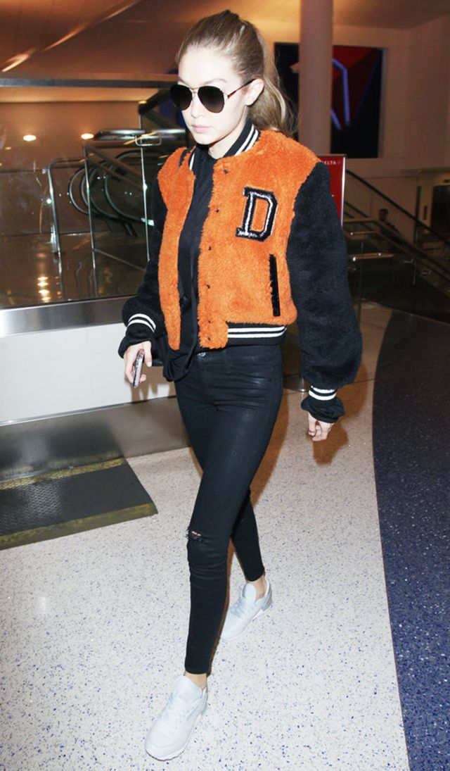On Gigi Hadid: Givenchy 56mm Aviator Sunglasses ($375); Diesel L-Mila Winter Jacket ($348); Hudson Deconstructed Waxed Super Skinny Jeans in Black ($209); Reebok Sneakers.