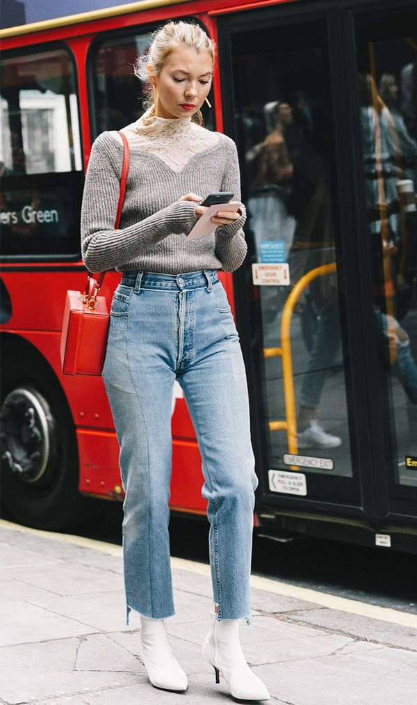 This is one look we'll want to wear on repeat—cropped jeans, a cozy sweater, and sleek white booties.