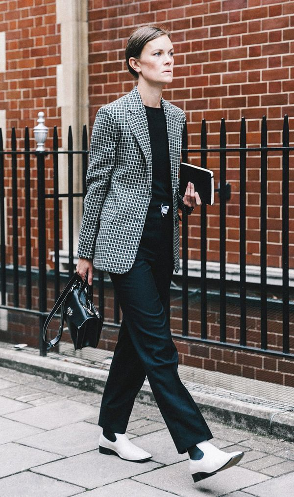 For a sophisticated yet forward work ensemble, go for a patterned blazer with trousers and flat white boots.