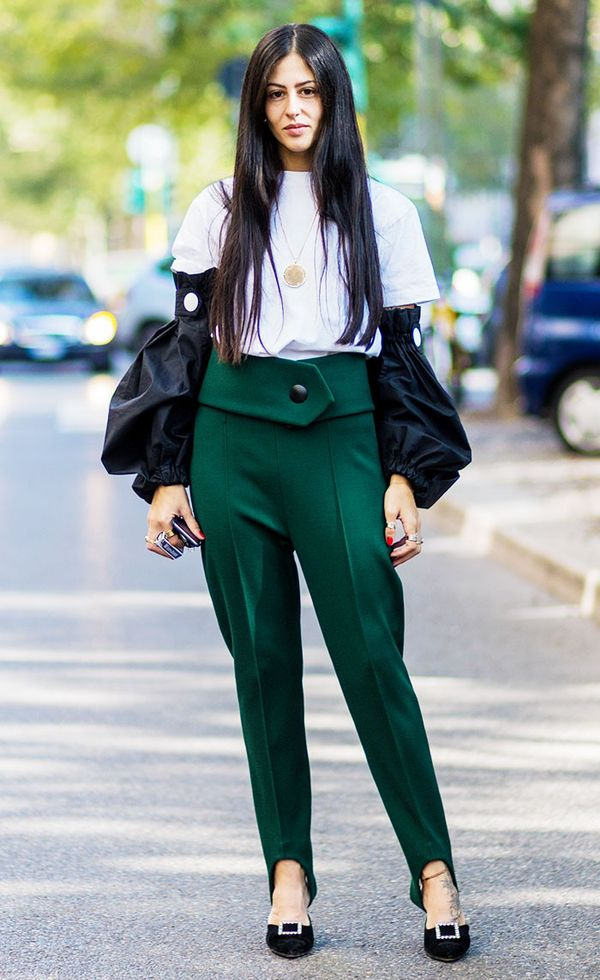 Gilda Ambrosio styled her high-waisted stirrup trousers with a plain white tee and statement sleeves.
