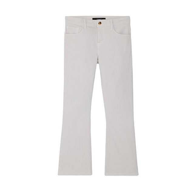 Pictured: J Brand Selena Mid-Rise Cropin Moonbeam, ($198) Corduroy cropped flares? Yes, please. Create a fresh monochromatic look with a simple sweater and sneakers. Winter white has never...