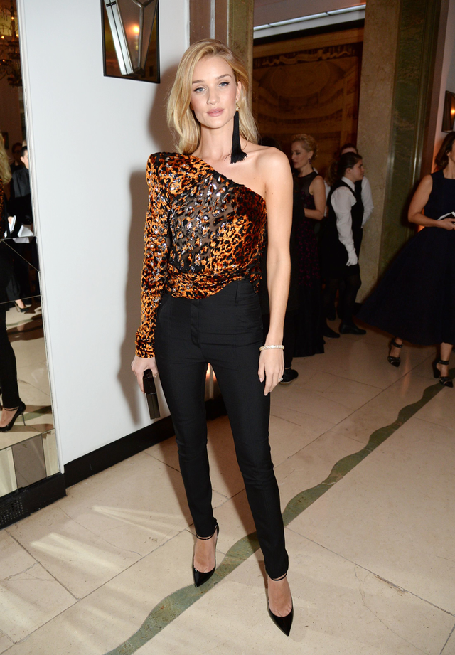 """On Rosie Huntington-Whiteley:Saint Laurent ensemble. Rosie Huntington-Whiteley's cheetah top not only hinted at the return of the """"going-out top"""" but also took on a character all its own."""