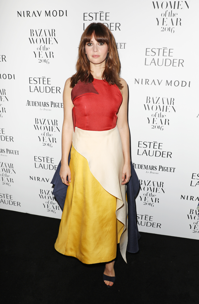 On Felicity Jones: Rosie Assoulin dress. Primary colors typically remind us of the circus, but with such an interesting and abstract shape, this Rosie Assoulin creation on Felicity Jones is much...