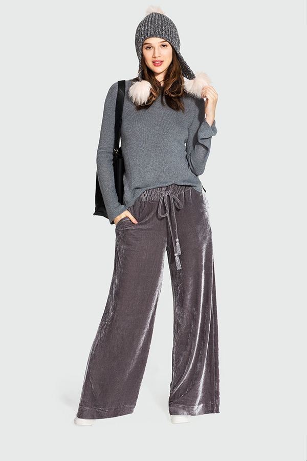 On Model: Who What Wear Bell Sleeve Crew Sweater ($30); Who What Wear Velvet Wide Leg Pant ($35); Who What Wear Pom Pom Earflap Beanie ($20); Who What Wear Slouchy Tote ($33).