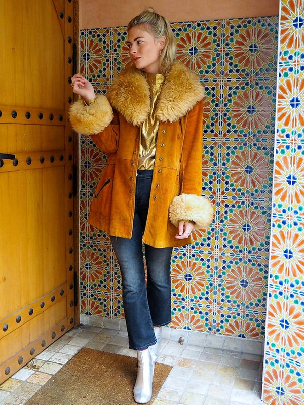 A shearling coat is not only incredibly stylish but also ideal for any super-cold day—especially paired with an eye-catching sweater, jeans, and ankle boots. On Pandora Sykes: Bella Freud...