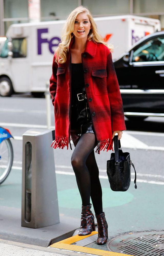 We absolutely love that the color of Elsa Hosk's fringe-detailed buffalo-check jacket was mimicked in her patterned booties.