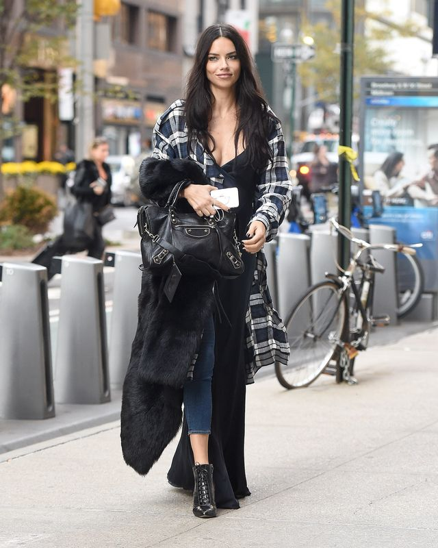 Adriana Lima proved that two jackets are even better than one in a casual knee-length plaid style and a more glamorous furry topper slung over her arm.