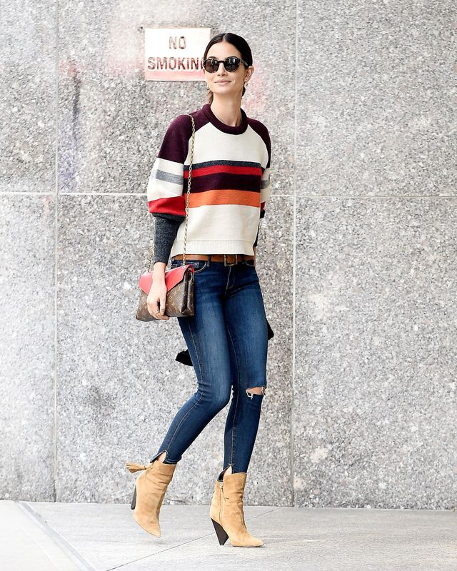 Lily Aldridge stepped out on her way to her Victoria's Secret Fashion Show fittings wearing a graphic sweater, blue jeans, and tan ankle boots. Perfection.
