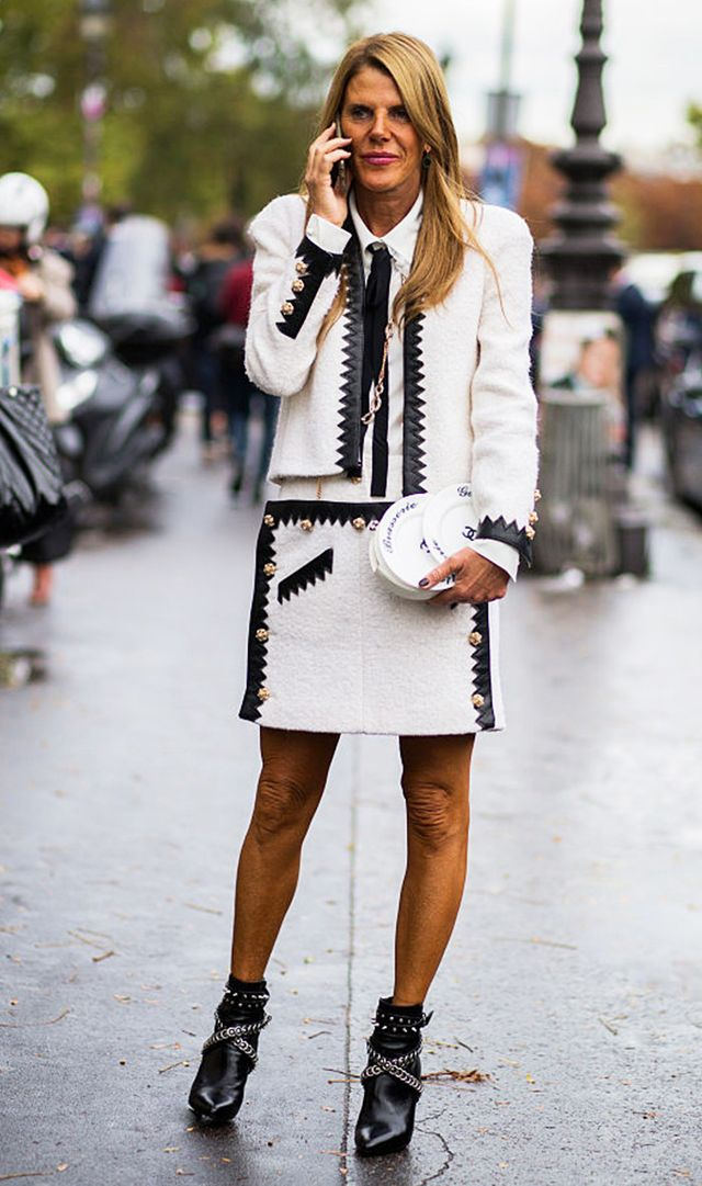 Anna Dello Russo wearing a suit set and pointed ankle booties