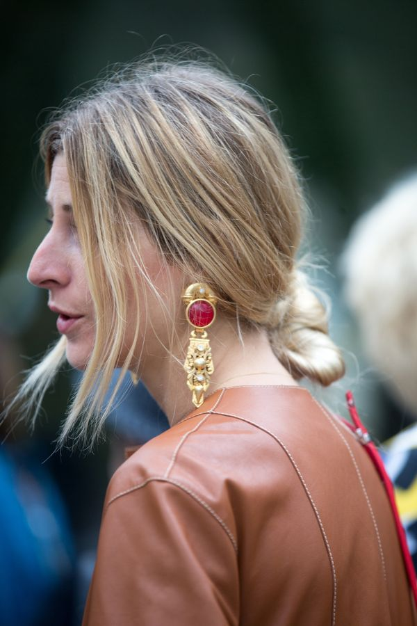 Next time you need to dress up a basic tee, throw your hair into a low bun and add oversized earrings.