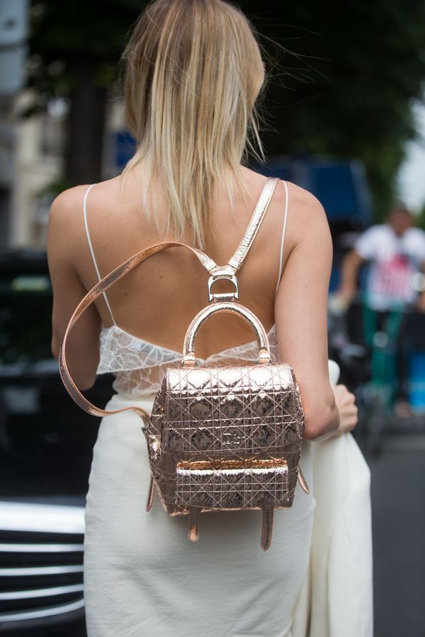 Summer = wearing an all-white look with a metallic backpack on the weekend.