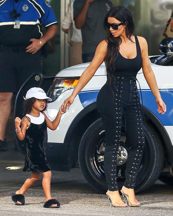 On Kim Kardashian West: Givenchy 58mm Sunglasses (£145); LPA Bodysuit 23 (£82): Yeezy Season 2 heels.