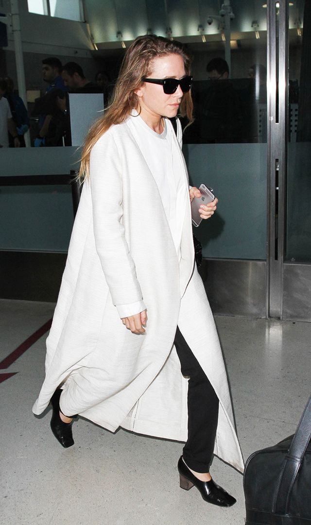 mary-kate wearing white at airport