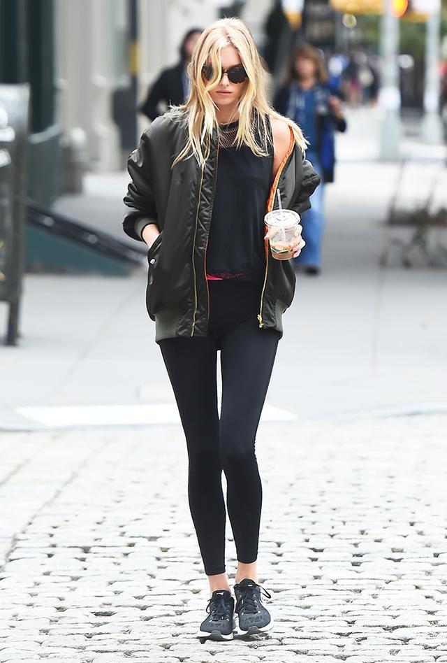 Elsa Hosk wearing leggings and bomber jacket in NYC