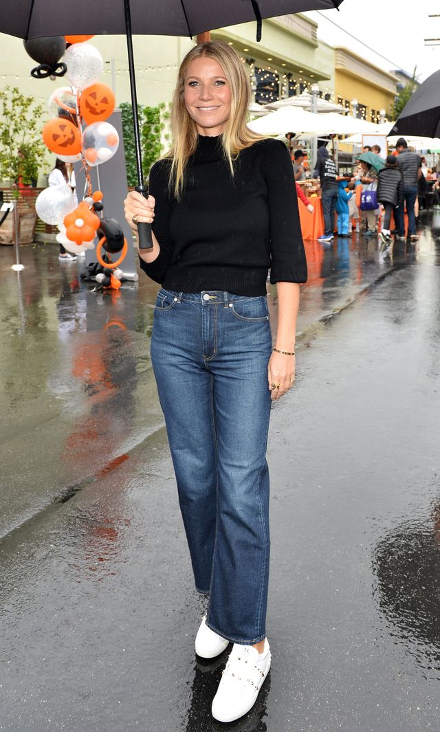 On Gwyneth Paltrow:Co Peasant Sleeve Sweater ($625);Rebecca TaylorLa Vie Anais Denim Jean($195); Valentino Rockstud Leather Sneakers ($795).