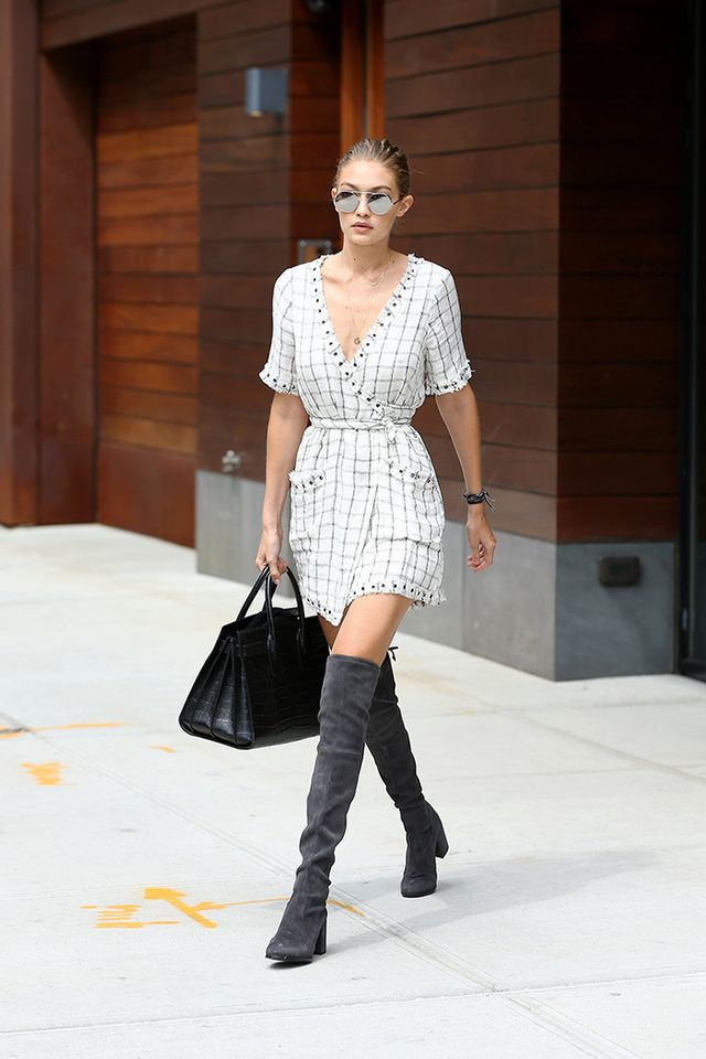 When she's not going for a skinny jeans look, you'll often spot Gigi in a throw-on dress, which she'll accent with cool boots and accessories.