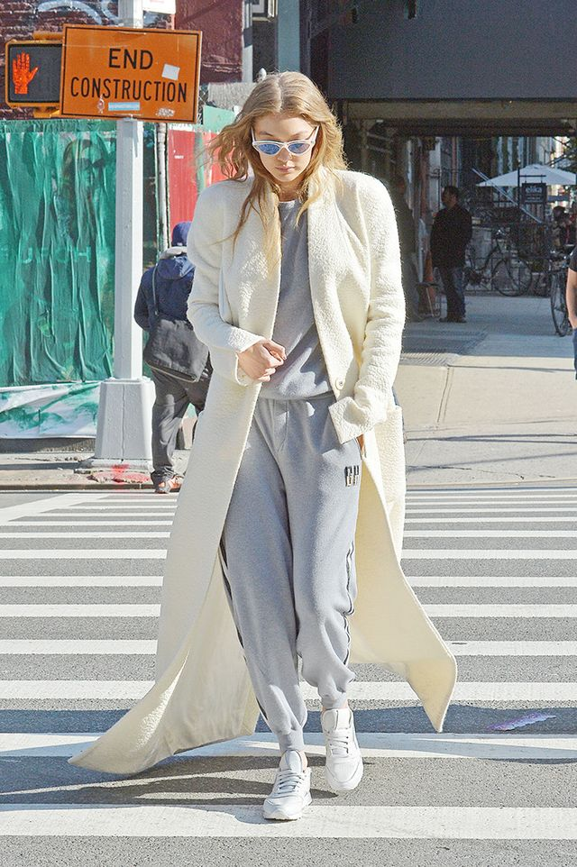 Yes, Gigi loves her booties—but she loves her white sneakers too. 