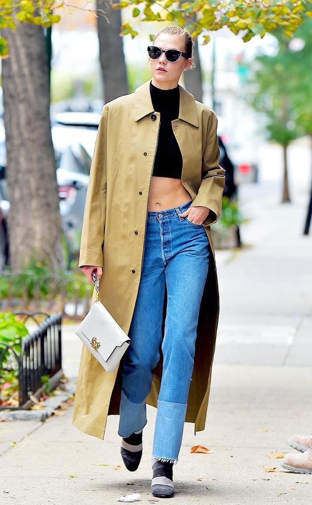 On Karlie Kloss: Anya Hindmarch Bathurst Python-Trimmed Leather Shoulder Bag ($2350); Anya Hindmarch Arcade Stripe Boots ($1200).