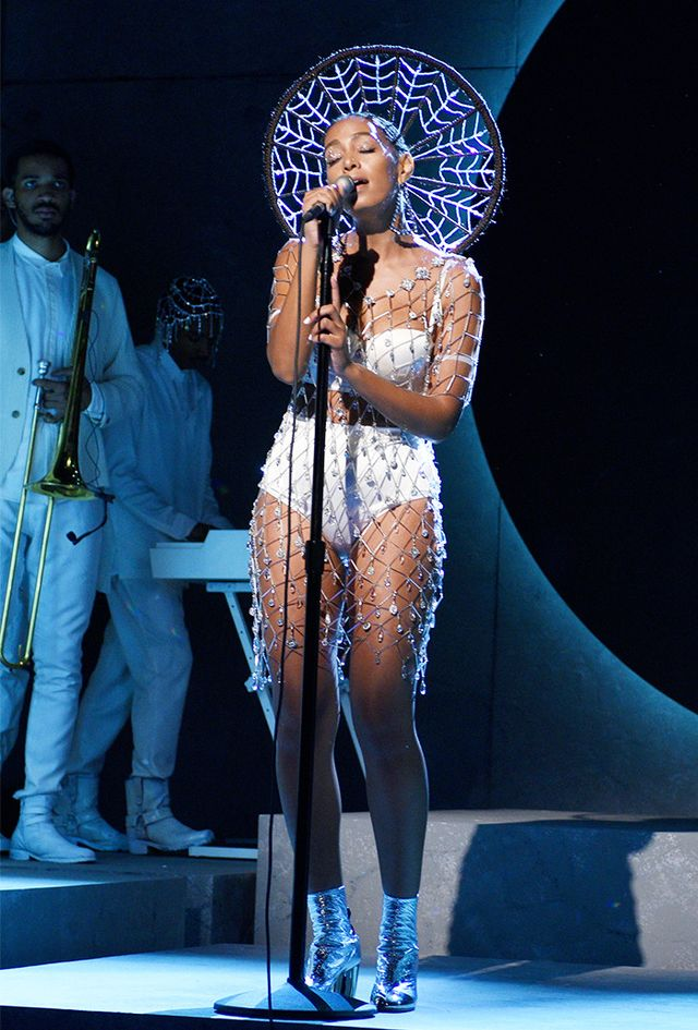 On Solange Knowles: Erickson Beamon dress; La Perla lingerie set. Head to the comments to share your thoughts on Solange Knowles's striking stage look, and then shop more dazzling pieces by...