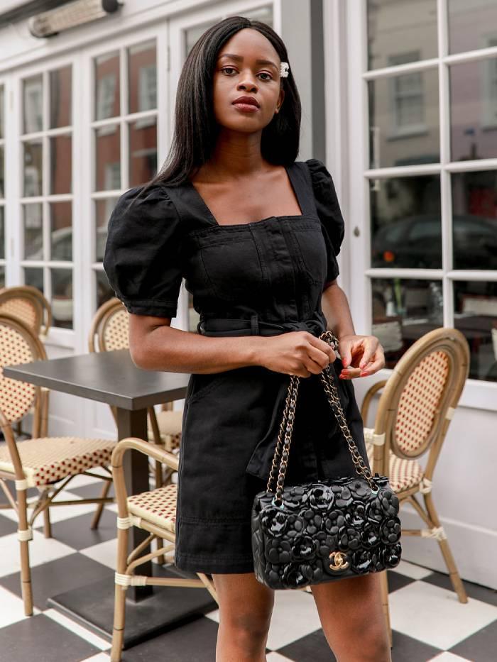 little black dress: enis wardrobe wearing a black dress