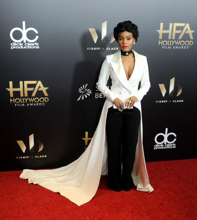 On Janelle Monae: Georges Chakra couture suit; Jimmy Choo clutch; Giuseppe Zanotti heels.