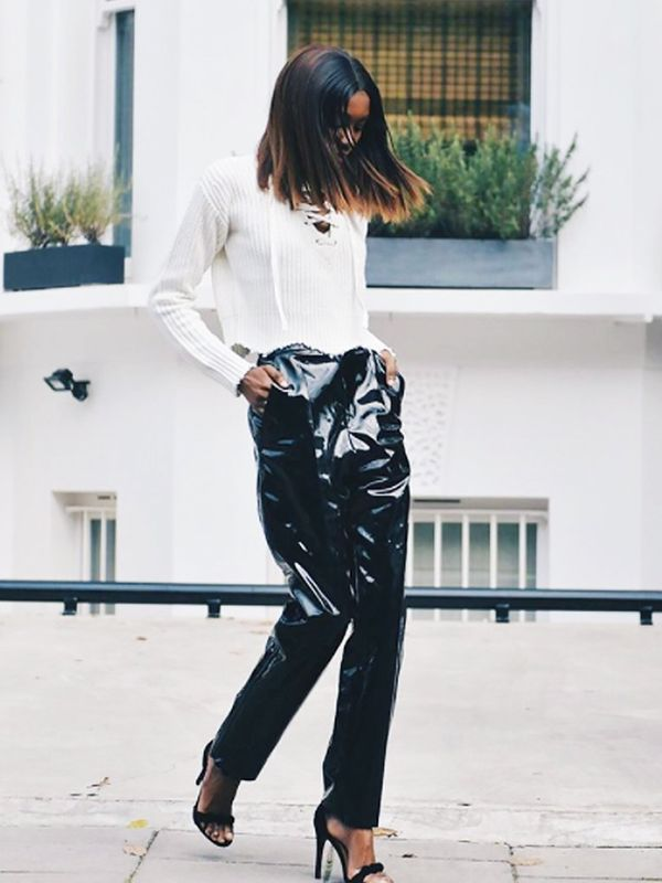 Style Notes: Natasha of Bisous Natasha tackles the PVC trend and wins. Why not soften the idea of wet-look trousers with a really cosy sweater? Heels turn this into a potential party ensemble too.
