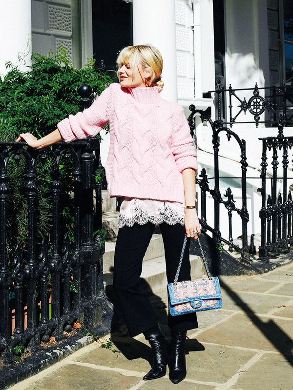 Style Notes: This pink sweater has been taking fashiontown by storm. Pandora Sykes ramps up her signature layering prowess by slipping on a little lace slip to peek out from underneath the...