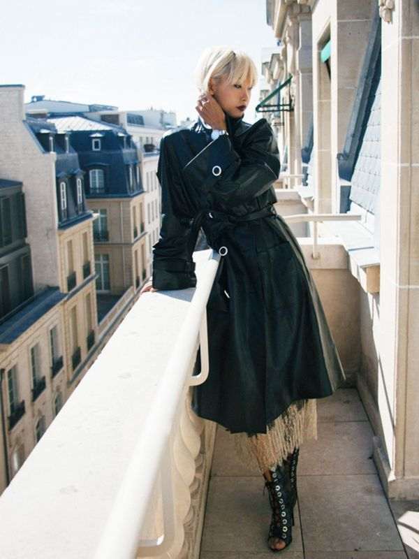 Style Notes: The idea of a leather trench coat and slip dress may sound OTT, but in a season where boudoir is a strong trend, it's no surprise. Vanessa Hong adds some extra femme fatale touches...