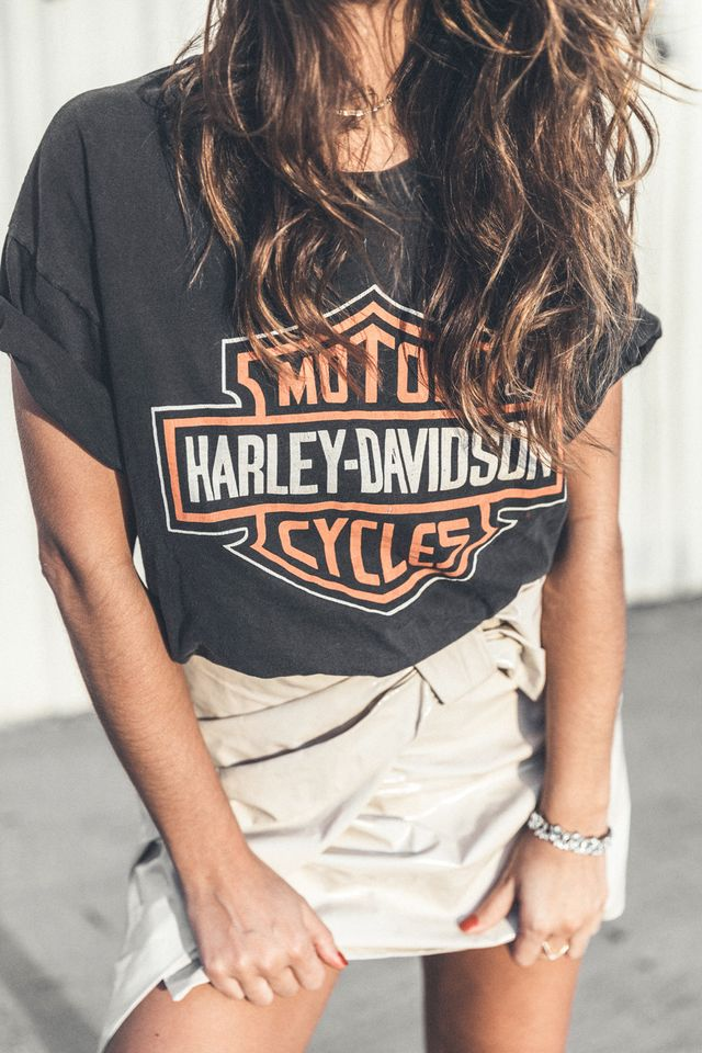 "Want to tone down a masculine outfit? ""Statement jewelry can be the perfect ally,"" says Escudero, who gave this vintage graphic tee and khaki skirt a feminine twist by adding a..."