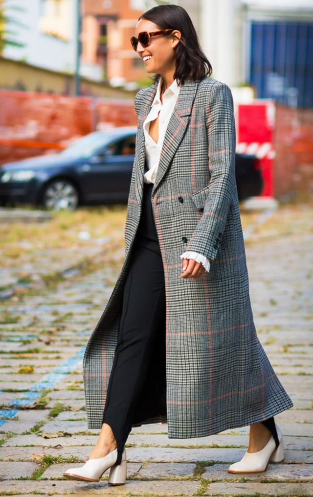 Rachel Wnag wearing leggings and coat