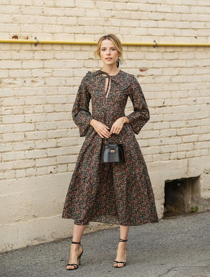 Wedding Guest Outfits 2019: Alex Noiret wears a Dôen floral dress and classic black accessories