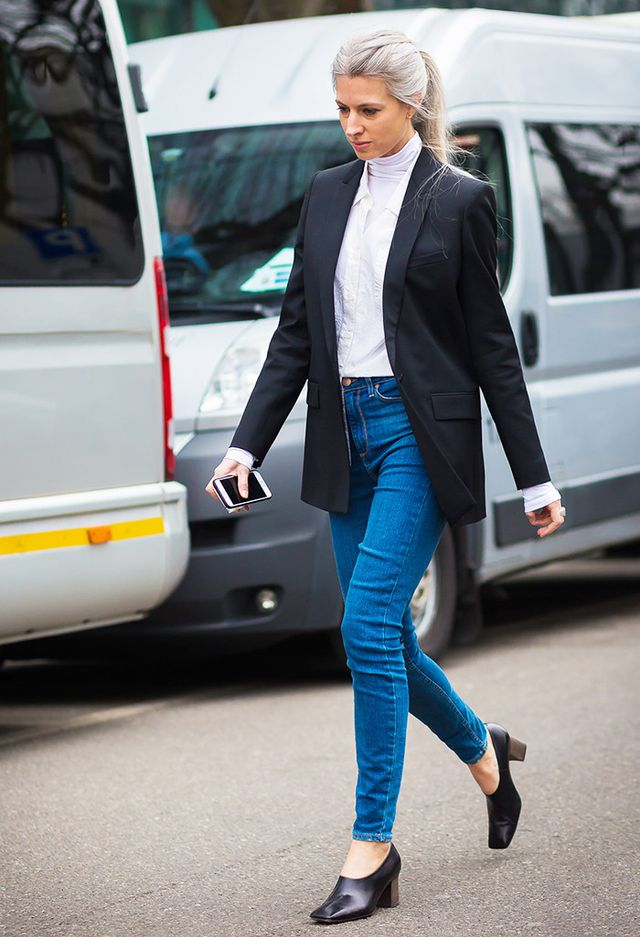 Sarah Harris street style in jeans, black blazer, blouse, and pumps