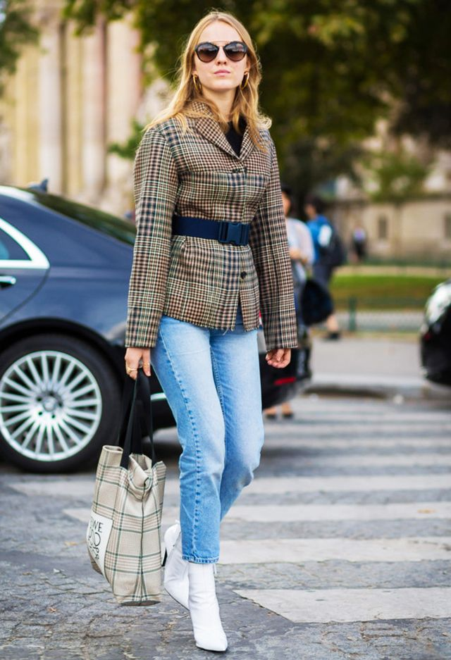 Alexandra Carl street style in plaid blazer, jeans, white boots, and belt