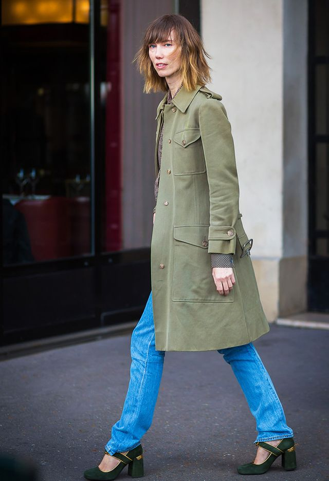 Anya Ziourova street style in jeans, military-style jacket, and Mary Janes.